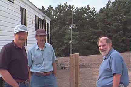 Co-operators George Heufelder of Barnstable County Health (left) and Tony Millham of the Buzzards Bay NEP meet onsite with Tom Jordan (right) of the NSF International (formerly the National Sanitation Federation) to discuss collaboration between the ETI Septic Test Center partners and NSF.