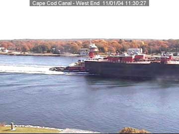 Barge travelling through the Cape Cod Canal.