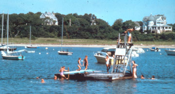 bathers on a raft in Buttermilk Bay, Bourne, MA