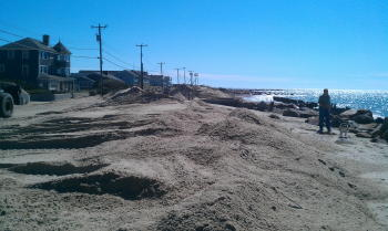 Sand being pushed off Menauhant Rd, back onto the beach.