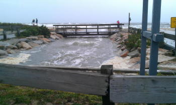 Elevated tides surging into Little Pond, Falmouth, near Falmouth Heights.