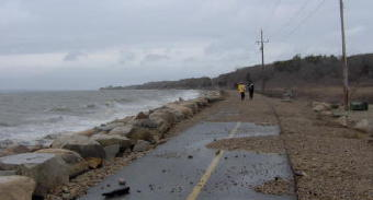 Shining Sea bikepath near Surf Drive was overtopped with waves during the night leaving much gravel and sand.